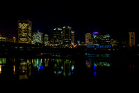 Take from the flood wall on the southside of Richmond Virginia the city colors reflect in the still of the James River